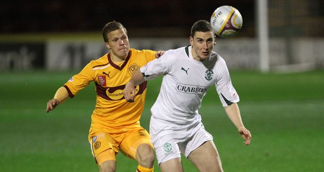 Henrik Ojamaa: Motherwell star and Hibernian's Paul Hanlon (right) battle it out