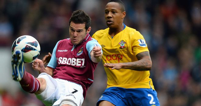 Matt Jarvis and Nathaniel Clyne challenge for the ball