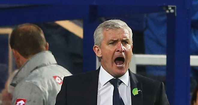 Mark Hughes: Confident QPR can improve despite another defeat to Arsenal
