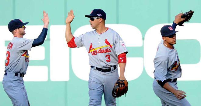 St Louis Cardinals: Shane Robinson, Carlos Beltran and Jon Jay celebrate victory