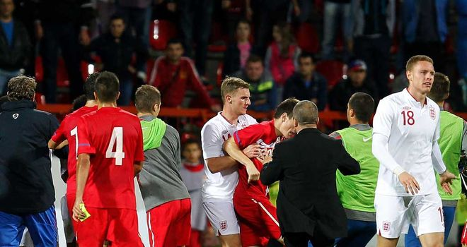 England players and staff: Clashed with Serbian opponents during play-off encounter in Krusevac