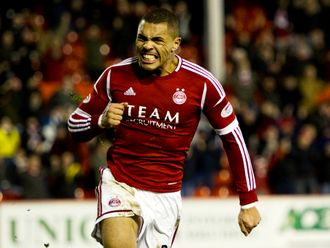 Josh Magennis: To stay at Pittodrie for the next 12 months.
