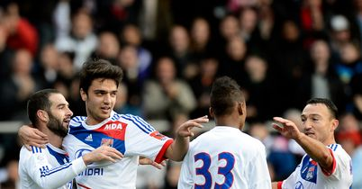 Lisandro Lopez (left): Celebrates his late goal for Lyon
