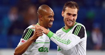 Naldo and Bas Dost celebrate their win over Hoffenheim