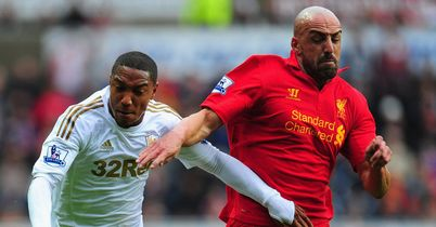 Swansea held firm to play out a goalless draw against Liverpool