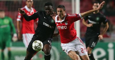Victor Wanyama and Nemanja Matic battle for the ball during the Group G clash in Lisbon