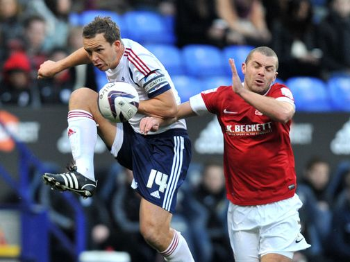 Kevin Davies and Stephen Dawson battle for the ball