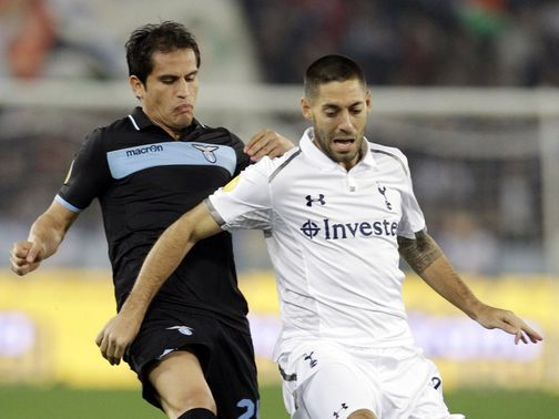 Cristian Ledesma and Clint Dempsey battle for the ball
