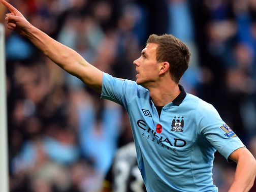 Edin Dzeko: Hoping to keep the pressure on Man United