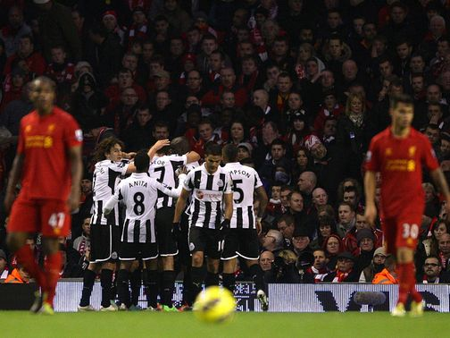 Newcastle celebrate after taking the lead at Anfield