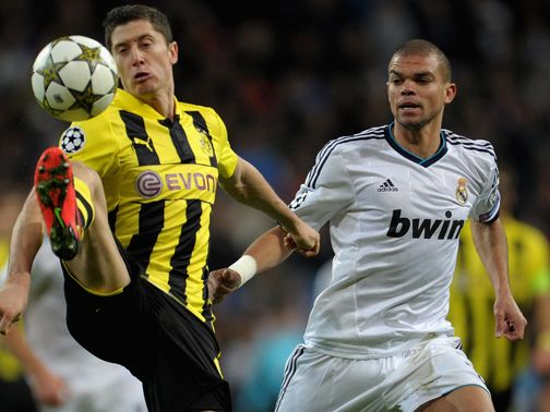 Robert Lewandowski brings the ball down as Pepe looks on