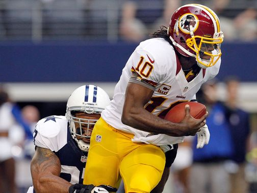 Robert Griffin III escapes the attention of Jason Hatcher