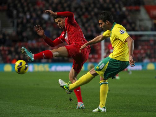 Gaston Ramirez blocks a cross from Javier Garrido