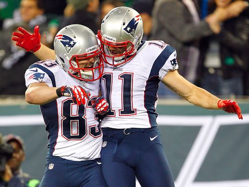 Wes Welker and Julian Edelman celebrate a touchdown