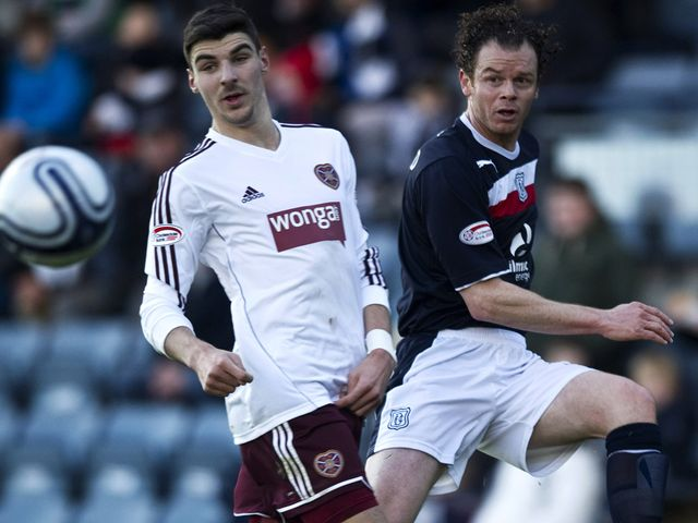 Matt Lockwood is challenged by Callum Paterson