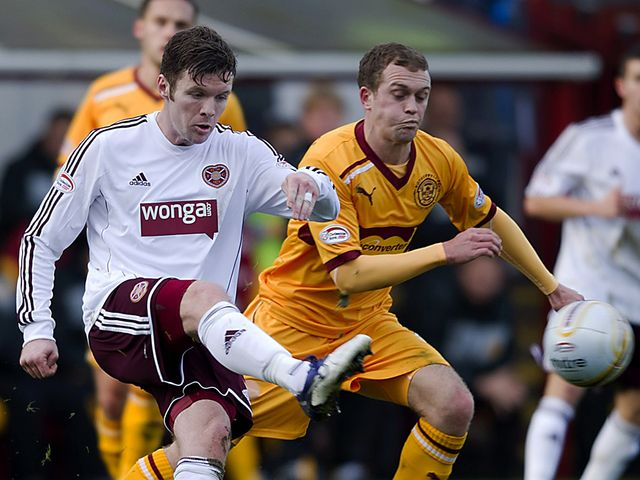 Darren Barr and Nicky Law battle for the ball