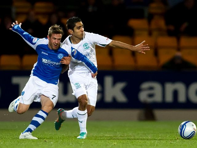 Chris Millar and Jorge Claros battle for the ball