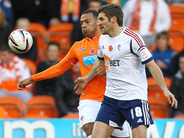 Matty Phillips and Sam Ricketts battle for the ball