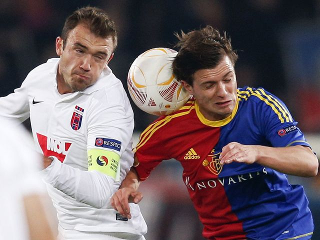 Gyorgy Sandor and Valentin Stocker battle for the ball