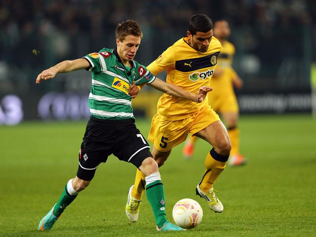 Patrick Herrmann and Stelios Parpas battle for the ball