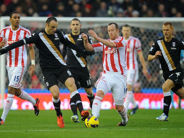 Dimitar Berbatov and Charlie Adam battle for the ball