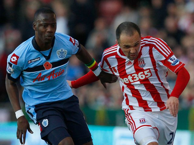 Samba Diakite and Matthew Etherington battle for the ball