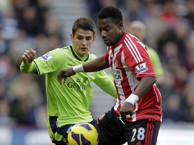 Westwood and Sessegnon battle for the ball