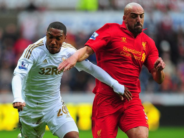Jonathan de Guzman and Jose Enrique battle for the ball