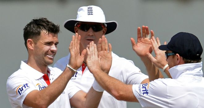 James Anderson (left) and Kevin Pietersen (centre): normal service resumed on England's tour of India