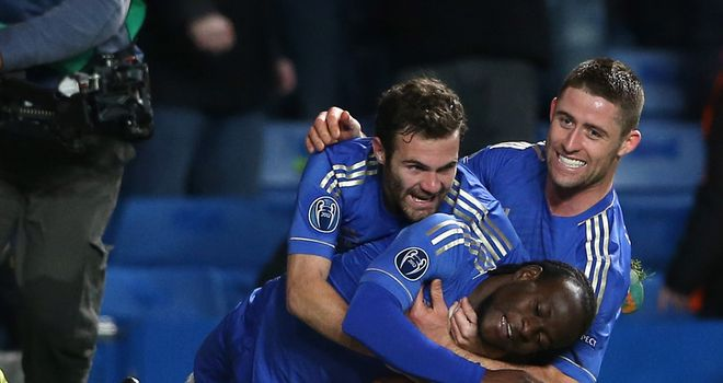 Moses: Chelsea's match-winner is congratulated by Mata and Cahill