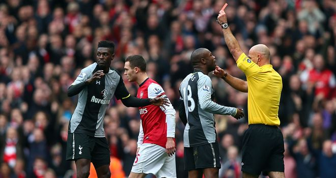 Seeing red: referee Howard Webb sends Adebayor off in the 17th minute