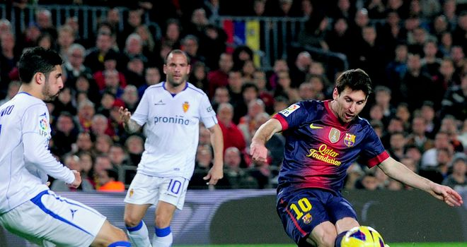 Familiar sight: Lionel Messi scores for Barca