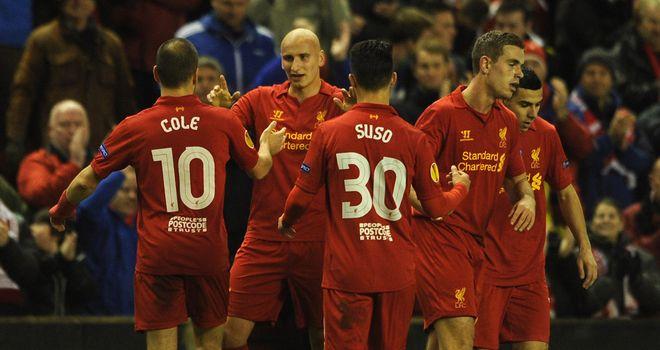Jonjo Shelvey celebrates his first half opener for Liverpool