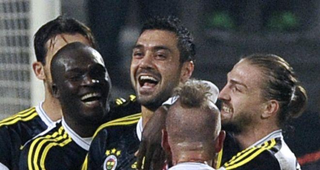 Bekir Irtegun is mobbed after scoring the winning goal for Fenerbahce