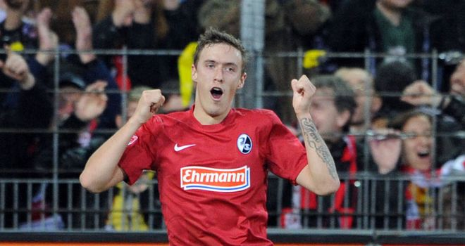 Max Kruse celebrates for Freiburg
