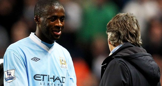 Roberto Mancini: Manchester City boss pleased with Yaya Toure's new contract