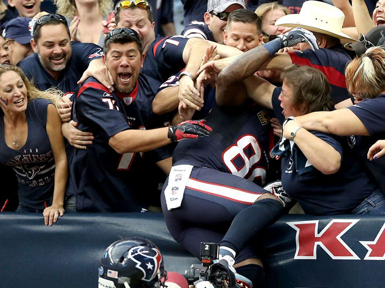 Andre Johnson leaps in the crowd after his dramatic TD
