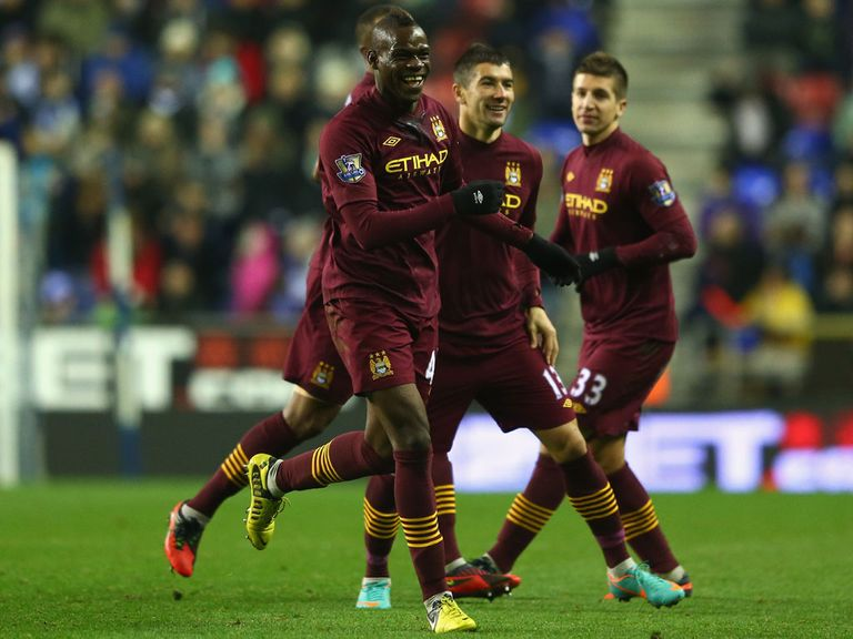 Mario Balotelli celebrates his goal at Wigan