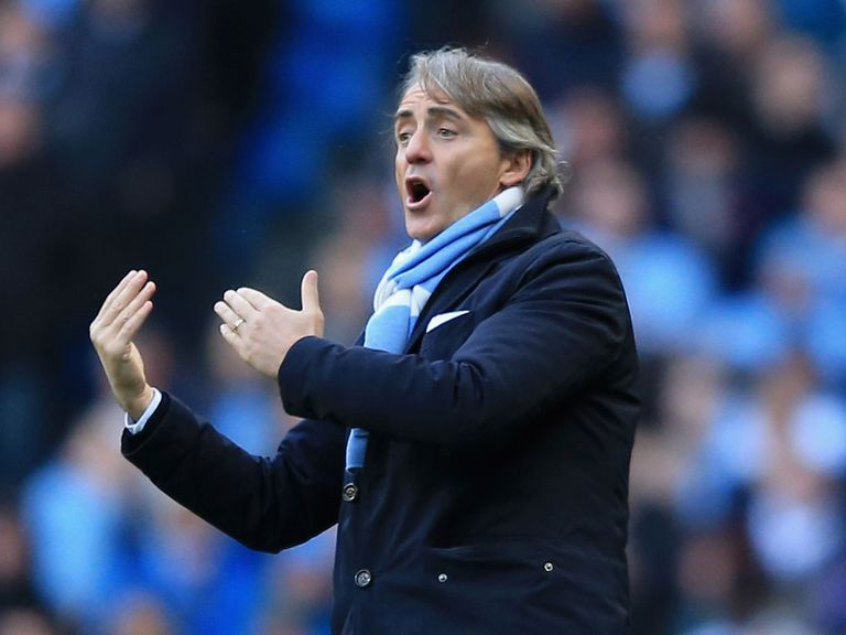 Roberto Mancini: His Man City side are struggling to keep up