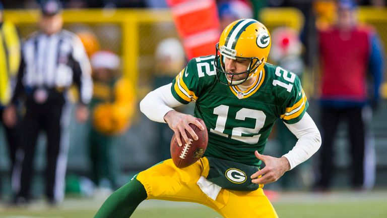 Aaron Rodgers: threw for three touchdowns and also ran for another for Green Bay