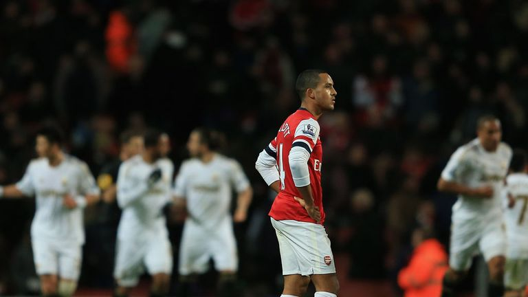 Theo Walcott: Arsene Wenger has urged England international to sign new deal