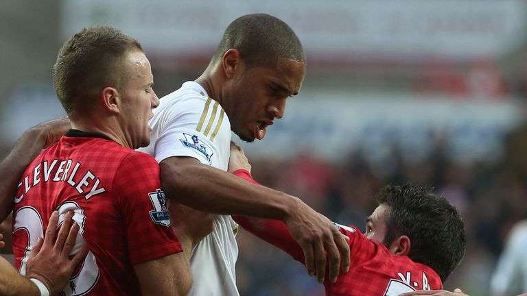 Ashley Williams was booked following his altercation with Robin van Persie