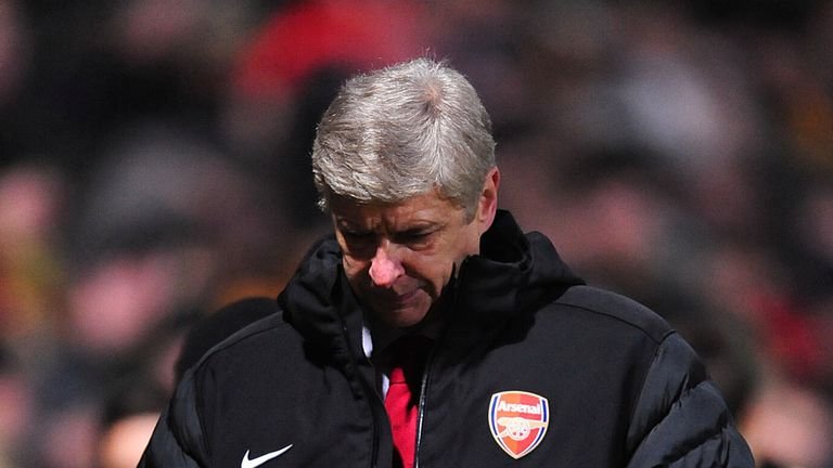 Arsene Wenger cut a forlorn figure after the Bradford defeat