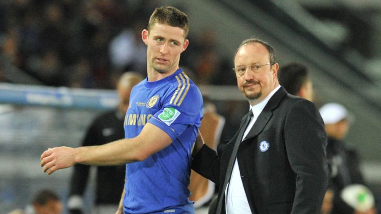 Gary Cahill: Helped down the tunnel by manager Rafa Benitez after his red card in Chelsea's Club World Final defeat.