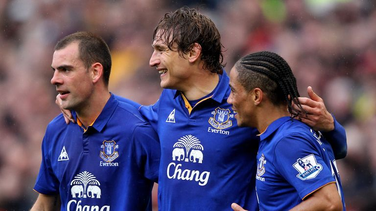 Nikica Jelavic celebrates a goal with Everton team-mates Darron Gibson and Steven Pienaar