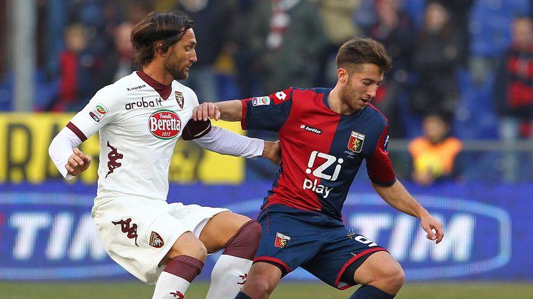 Andrea Bertolacci vies with Rolando Bianchi