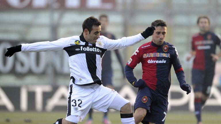 Marco Marchionni challenges Andrea Cossu