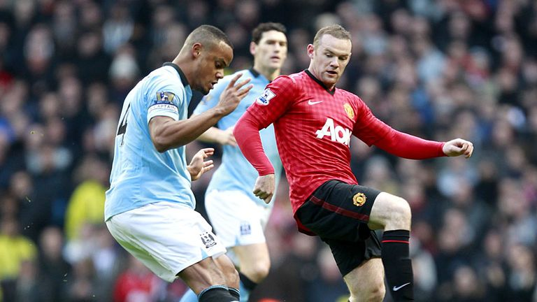 Vincent Kompany (left) in action during the Manchester derby