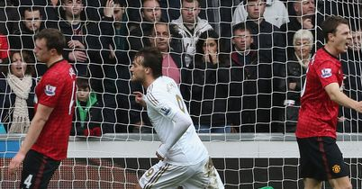 Michu: Celebrates his equaliser for Swansea