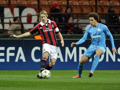 Massimo Ambrosini and Axel Witsel battle for possession